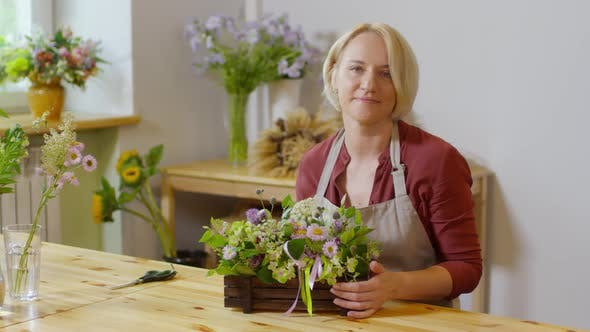 Thumbnail for Florist Posing with Tasteful Floral Arrangement