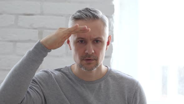 Cover Image for Searching Gesture by Middle Aged Man in Office