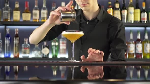 Thumbnail for Bartender Making Fresh Alcoholic Cocktail on Bar Counter
