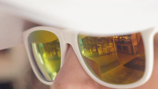 Cover Image for Close-up of Woman Wearing Mirrored Sunglasses
