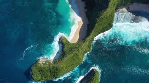 Kelingking beach, Nusa Penida, Bali, Indonesia. Aerial view at sea and rocks.