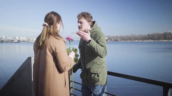 Cover Image for Young Caucasian Couple Arguing Outdoors. Nervous Chubby Girl Returning Pink Rose To Man and Leaving