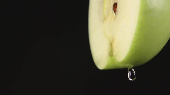 Thumbnail for Drops Of A Juice Drip From A Green Apple