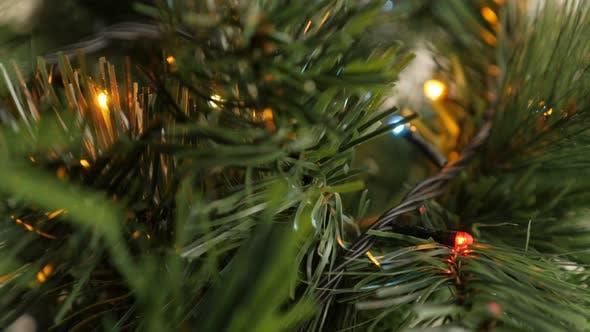 Thumbnail for Beautiful mini   colorful bulbs blinking on Christmas tree 4K 2160p 30fps UltraHD footage - Fairy li