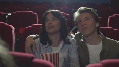 Couple Watching Comedy in Cinema