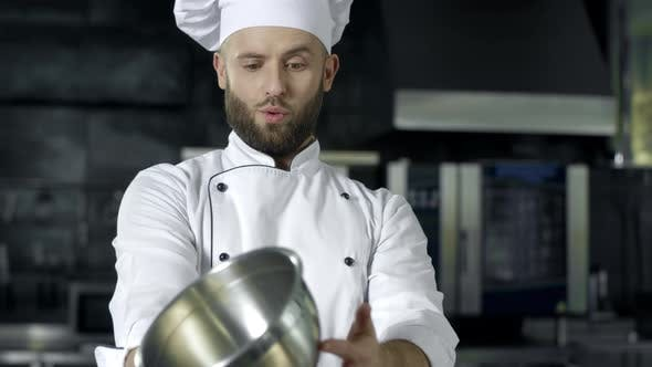 Thumbnail for Chef Playing with Bowl. Chef Man Preparing To Cook at Professional Kitchen