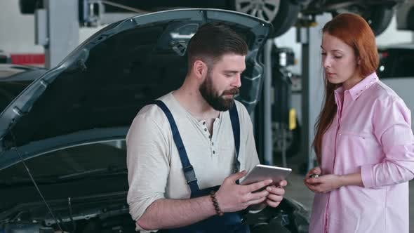 Thumbnail for Mechanic Making Deal with Female Customer