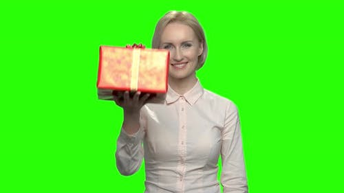 Businesswoman with Red Gift Box and Thumb Up