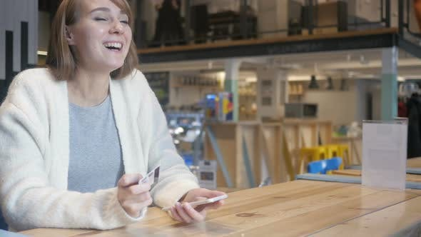 Thumbnail for Woman Reacting to Successful Online Shopping on Smartphone