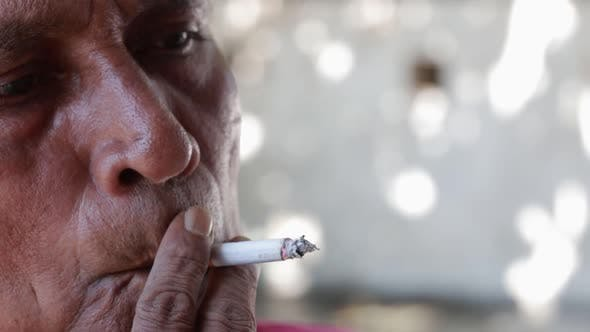 Cover Image for Old Asian Indian Man Smoking A Cigarette