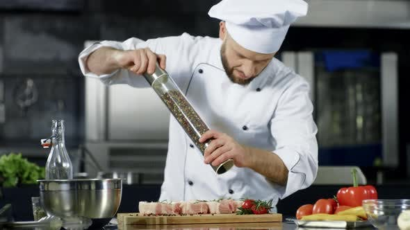 Thumbnail for Male Chef Peppering Meat at Kitchen. Closeup Chef Peppering Steak at Workplace