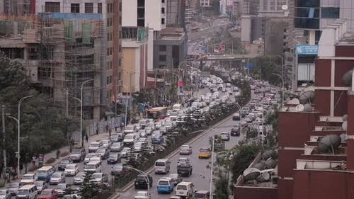 Heavy stream of traffic passing in downtown Addis Ababa, Ethiopia, Africa.
