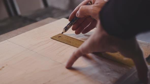 Carpenter Measuring And Marking Wood