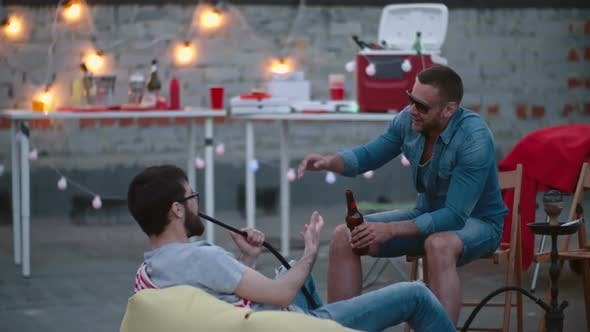 Cover Image for Male Friends Chilling on Rooftop