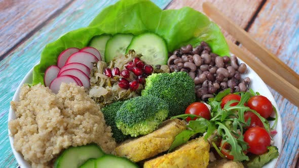 Thumbnail for Buddha Bowl With Quinoa, Chickpea Falafel Patties, Red Beans And Salad. Healthy Vegan Food Concept.