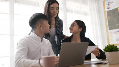 Woman mentor coach helping Colleagues