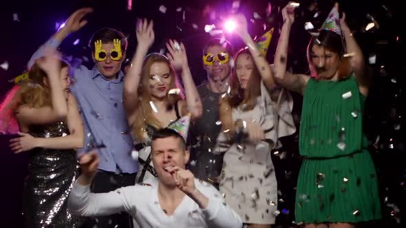 Thumbnail for Young People Dancing and Throws Glitter Confetti at the Party