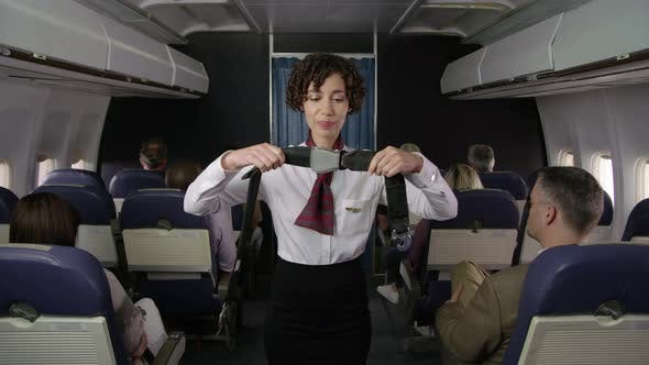 Thumbnail for Airliner flight attendant explaining safety rules