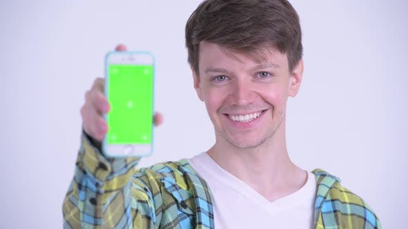 Thumbnail for Face of Happy Young Handsome Man Showing Phone