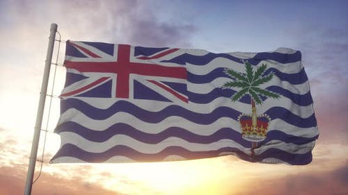 Flag of British Indian Ocean Territory Waving in the Wind Sky and Sun Background