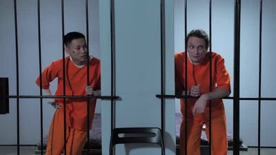 Criminal Laughs at Cellmate's Joke