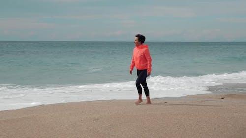 Walking on sandy beach