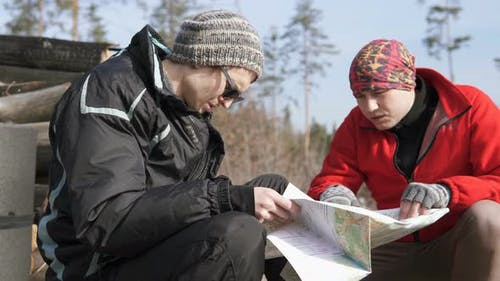 Two Tourists in the Forest Make a Route on the Map