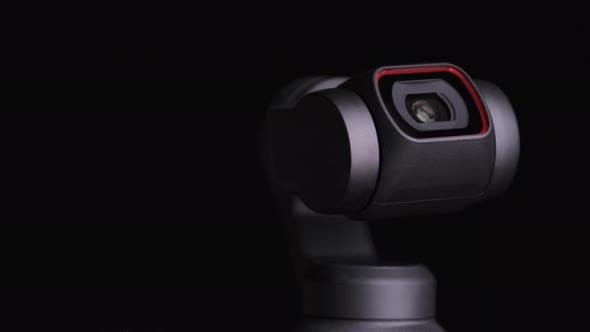 Thumbnail for Mechanical Gimbal Camera Lens Rotates on Black Background Robotic Camera Macro