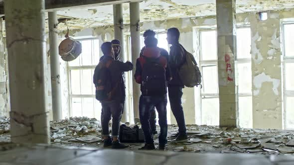 Thumbnail for Male Arab Refugees Chatting in Abandoned Building