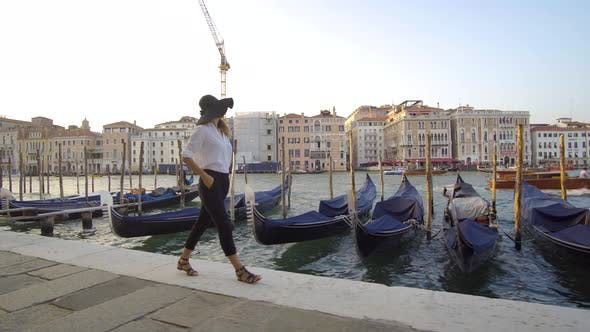 Thumbnail for Girl Walking in Venice Near Gondolas, Italy