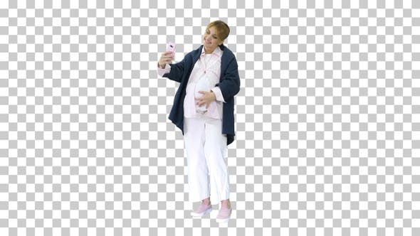 Happy young pregnant woman taking selfie, Alpha Channel