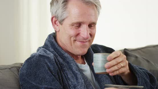 Thumbnail for Senior man smiling looking at camera with tea