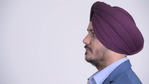 Thumbnail for Profile View of Bearded Indian Sikh Businessman Thinking