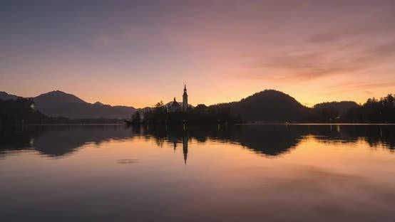 Thumbnail for Timelapse View of the Colorful Forest and Lake Bled with a Small Island with a Church. Sunrise