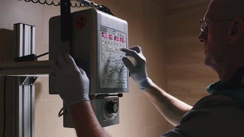 Veterinarian Adjusting X-Ray Machine