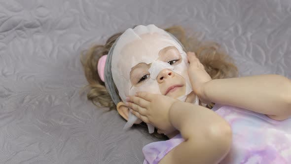Thumbnail for Teen Girl Applying Moisturizing Face Mask. Child Kid Take Care of Skin with Cosmetic Facial Mask