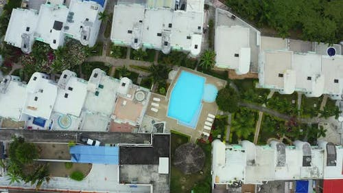 Aerial top down view of a resort with white buildings