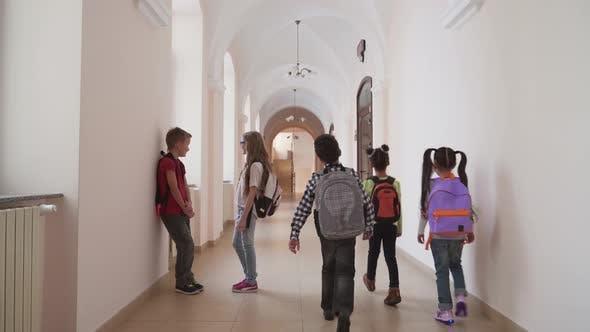 Thumbnail for Children Talking in School Hallway During Break.