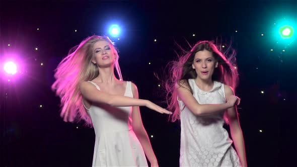 Cover Image for Girls Are Dancing Making the Similar Gestures. Slow Motion