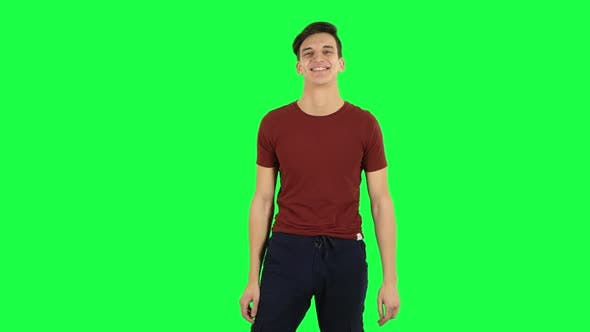 Cover Image for Guy Smiling While Looking at Camera and Flirting. Green Screen