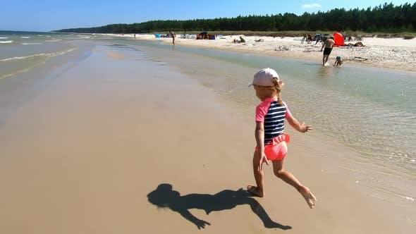 Little Girl Running On Beach.