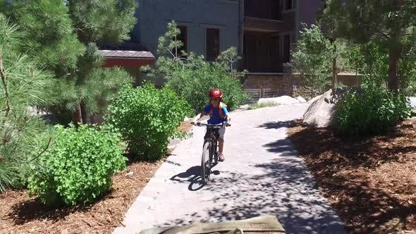 Thumbnail for A boy rides his mountain bike on a path.