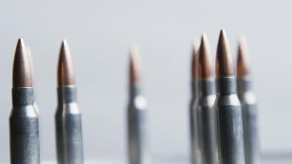 Cinematic rotating shot of bullets on a metallic surface - BULLETS 021