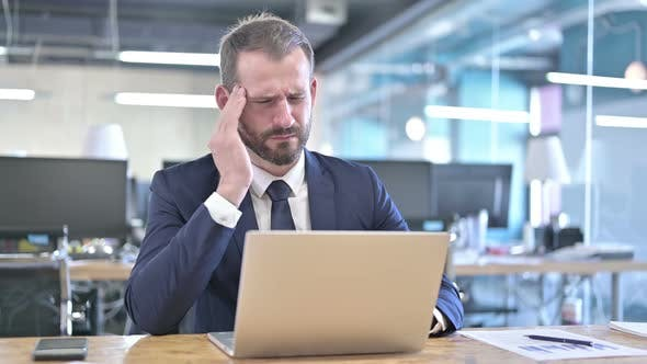 Thumbnail for Tired Young Businessman Having Headache in Office