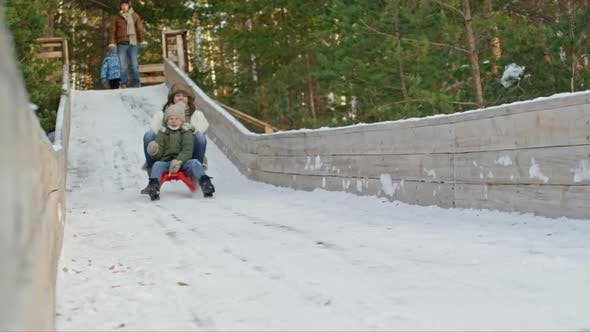 Thumbnail for Screaming Woman and Boy on Sled