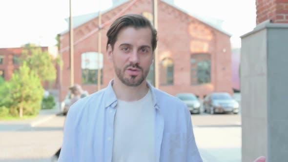 Walking Man Talking on Online Video Call Outdoor