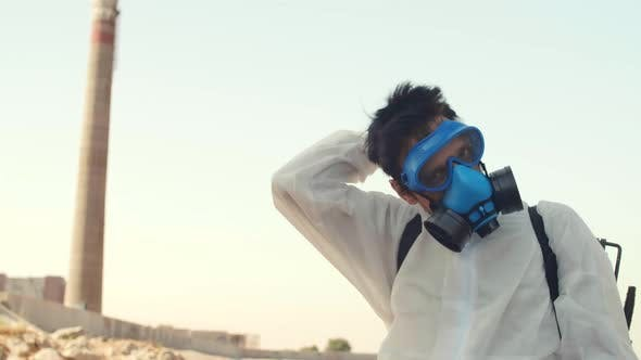 Thumbnail for Man Taking off Safety Goggles and Mask