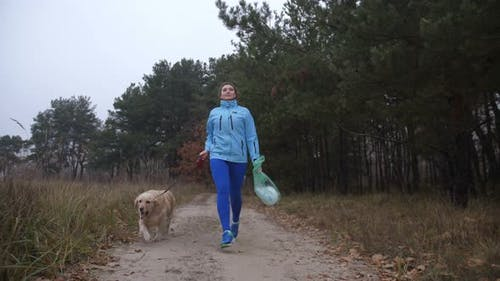 Environment Friendly Girl with Pet Plogging Outdoor