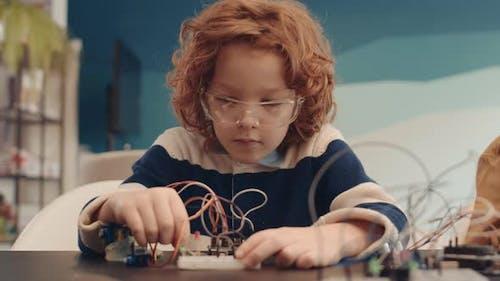 Ginger Schoolboy Constructing Robot