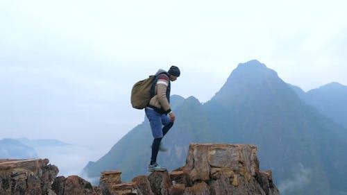 Hiker Hiking At Mountain Top